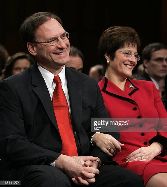 Samuel Alito President George W Bush's nominee for Associate Justice of the Supreme Court and his wife Martha listen to his introduction before he is...