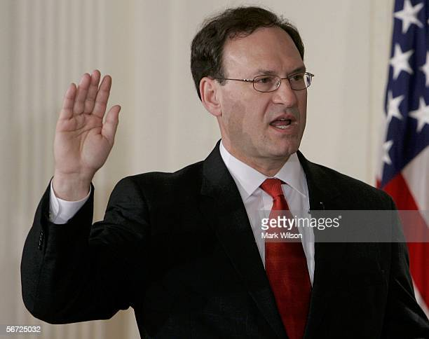 Samuel Alito raises his right hand as he is sworn in as Associate Justice of the United States Supreme Court during a ceremony in the East Room at...