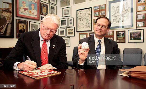 Samuel Alito the Republican White House nominee for the US Supreme Court met with Sen Jim Bunning Bunning presented Alito with a baseball and signed...