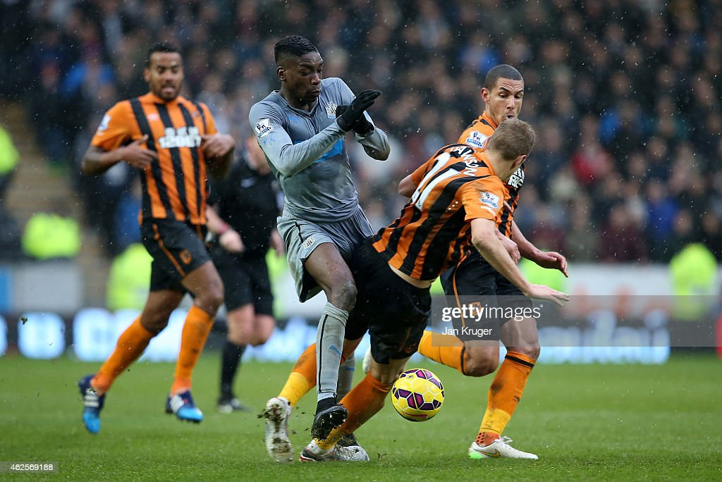 Samuel Ameobi of Newcastle United is tackled by Michael Dawson of Hull City during the Barclays Premier League match between Hull City and Newcastle United at KC Stadium on January 31, 2015 in Hull, England.