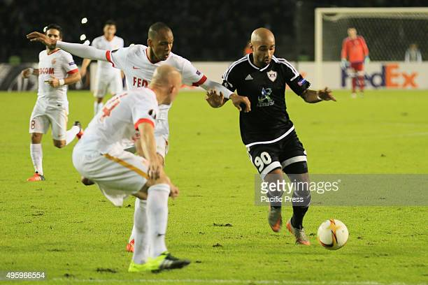 Samuel Armenteros of Qarabag challenges Andrea Raggi of Monaco during their match at UEFA Europa League group J football