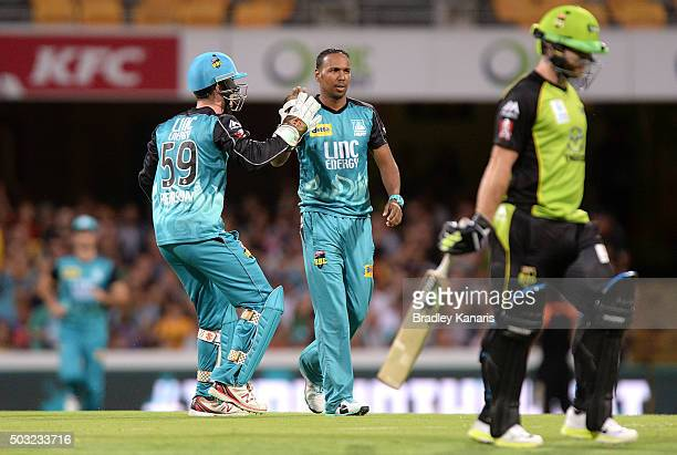 Samuel Badree of the Heat celebrates taking the wicket of Aiden Blizzard of the Thunder during the Big Bash League match between the Brisbane Heat...