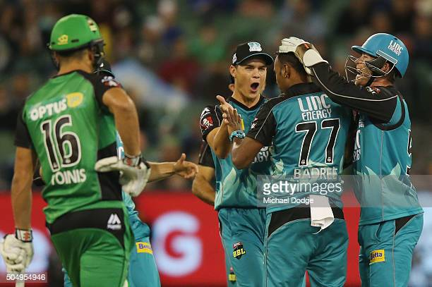 Samuel Badree of the Heat celebrates the wicket of Kevin Pietersen of the Stars during the Big Bash League match between the Melbourne Stars and the...