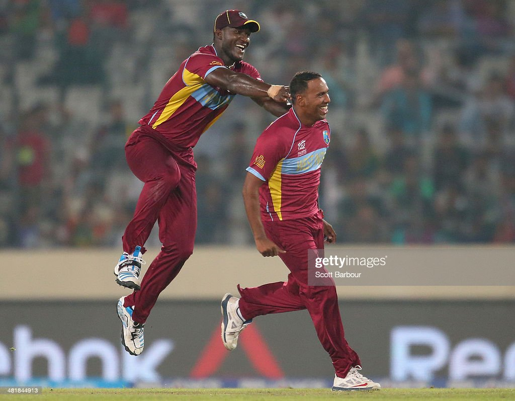 Samuel Badree of the West Indies is congratulated by Darren Sammy after dismissing Shoaib Malik of Pakistan during the ICC World Twenty20 Bangladesh 2014 match between West Indies and Pakistan at Sher-e-Bangla Mirpur Stadium on April 1, 2014 in Dhaka, Bangladesh.