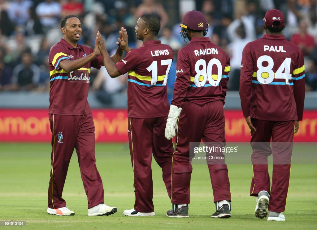 Samuel Badree of West Indies celebrates dissmissing Dinesh Karthik of the ICC World XI with his team mate Evin Lewis of West Indies who caught his bowl during the Hurricane Relief T20 match between the ICC World XI and West Indies at Lord's Cricket Ground on May 31, 2018 in London, England.