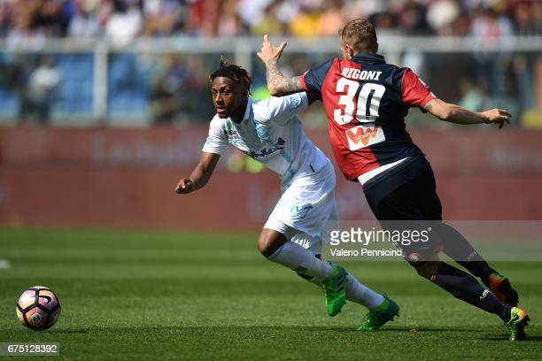 Samuel Bastien of AC ChievoVerona in action against Luca Rigoni of Genoa CFC during the Serie A match between Genoa CFC and AC ChievoVerona at Stadio...
