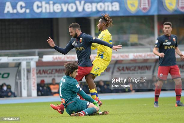 Samuel Bastien of Chievo Verona competes with Nicolas Spolli and Mattia Perin goalkeeper of Genoa during the serie A match between AC Chievo Verona...