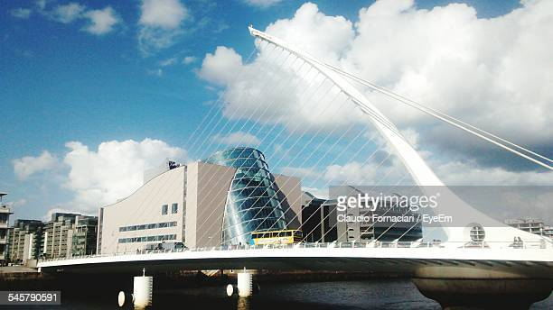 Samuel Beckett Bridge And Buildings Against Cloudy Sky