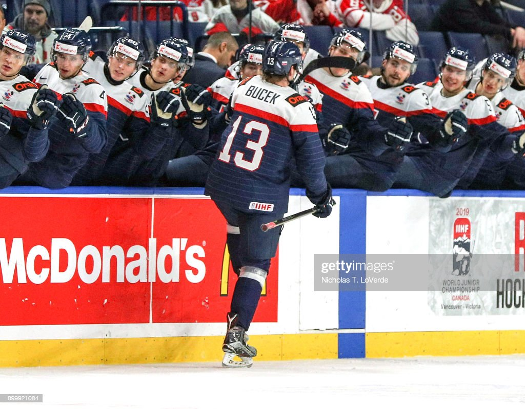 Samuel Bucek #13 of Slovakia celebrates his third period goal with teammates that cut Finland's lead to 3-2 during the IIHF World Junior Championships at the KeyBank Center on December 30, 2017 in Buffalo, New York.
