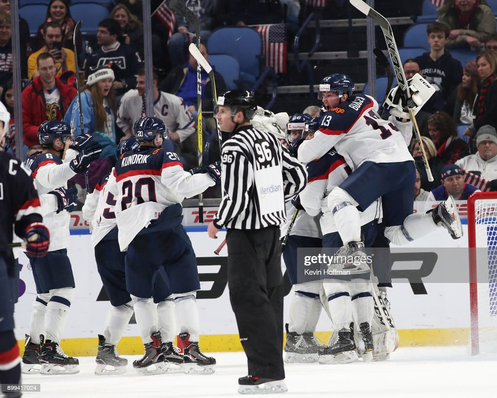 Samuel Bucek #13 of Slovakia celebrates with teammates after beating against the United States the IIHF World Junior Championship at KeyBank Center on December 28, 2017 in Buffalo, New York. Slovakia beat the United States 3-2.