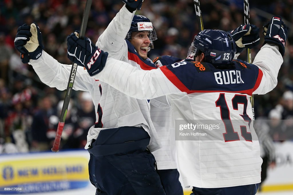 Samuel Bucek #13 of Slovakia celebrates with teammates after scoring the winning goal against the United States in the third period during the IIHF World Junior Championship at KeyBank Center on December 28, 2017 in Buffalo, New York. Slovakia beat the United States 3-2.