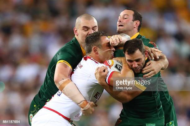 Samuel Burgess of England is tackled during the 2017 Rugby League World Cup Final between the Australian Kangaroos and England at Suncorp Stadium on...