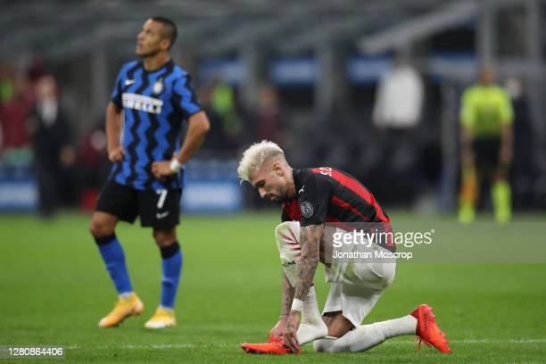 Samuel Castillejo of AC Milan adjusts his boot during the Serie A match between FC Internazionale and AC Milan at Stadio Giuseppe Meazza on October...
