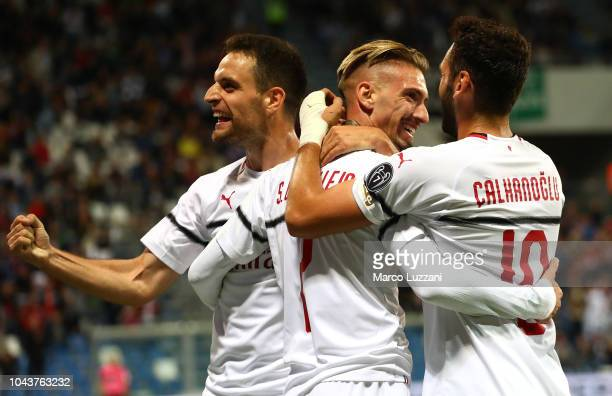 Samuel Castillejo of AC Milan celebrates his goal with his teammates Giacomo Bonaventura and Hakan Calhanoglu during the Serie A match between US...