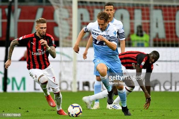 Samuel Castillejo of AC Milan compete for the ball with Lucas Leiva of SS Lazio during the TIM Cup match between AC Milan and SS Lazio at Stadio...