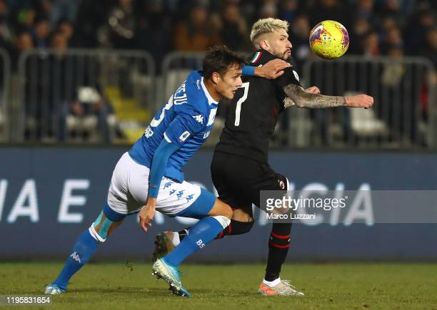Samuel Castillejo of AC Milan competes for the ball with Ales Mateju of Brescia Calcio during the Serie A match between Brescia Calcio and AC Milan...
