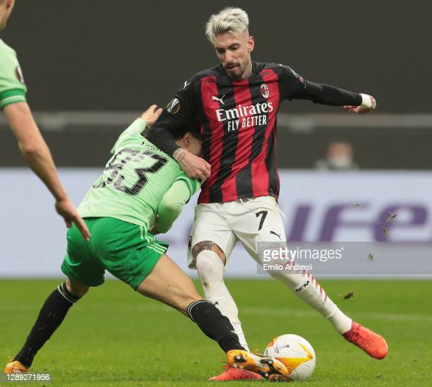 Samuel Castillejo of AC Milan competes for the ball with Diego Laxalt of Celtic FC during the UEFA Europa League Group H stage match between AC Milan...