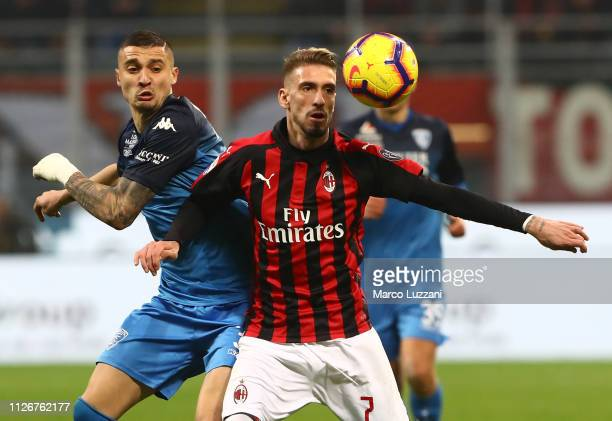 Samuel Castillejo of AC Milan competes for the ball with Rade Krunic of Empoli during the Serie A match between AC Milan and Empoli at Stadio...