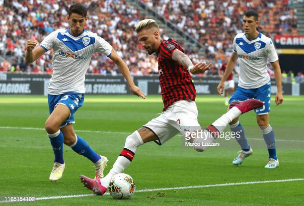 Samuel Castillejo of AC Milan is challenged by Andrea Cistana of Brescia Calcio during the Serie A match between AC Milan and Brescia Calcio at...