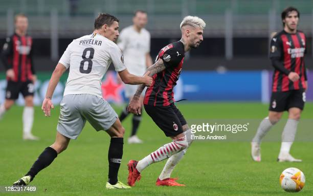 Samuel Castillejo of AC Milan is challenged by David Pavelka of AC Sparta Praha during the UEFA Europa League Group H stage match between AC Milan...