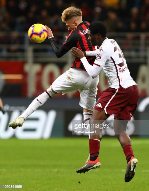 Samuel Castillejo of AC Milan is challenged by Ola Aina of Torino FC during the Serie A match between AC Milan and Torino FC at Stadio Giuseppe...