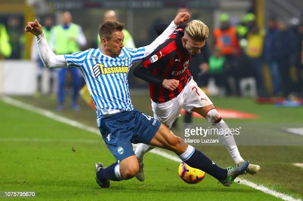 Samuel Castillejo of AC Milan is challenged by Thiago Cionek of SPAL during the Serie A match between AC Milan and SPAL at Stadio Giuseppe Meazza on...