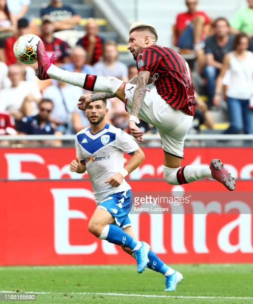 Samuel Castillejo of AC Milan kicks the ball in the air during the Serie A match between AC Milan and Brescia Calcio at Stadio Giuseppe Meazza on...