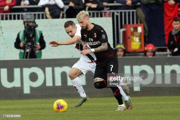 Samuel Castillejo of Milan in contrast with Marko Rog of Cagliari during the Serie A match between Cagliari Calcio and AC Milan at Sardegna Arena on...