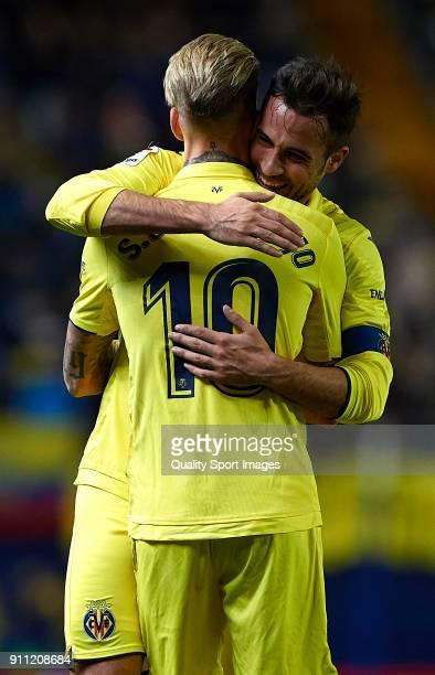 Samuel Castillejo of Villarreal celebrates after scoring his sides fourth goal with his teammate Mario Gaspar during the La Liga match between...