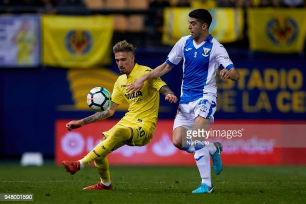 Samuel Castillejo of Villarreal CF competes for the ball with Arribas of CD Leganes during the La Liga game between Villarreal CF and Club Deportivo...