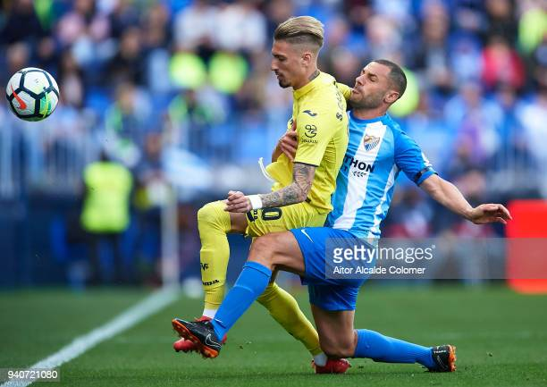 Samuel Castillejo of Villarreal CF competes for the ball with Medhi Lacen of Malaga CF during the La Liga match between Malaga and Villarreal at...