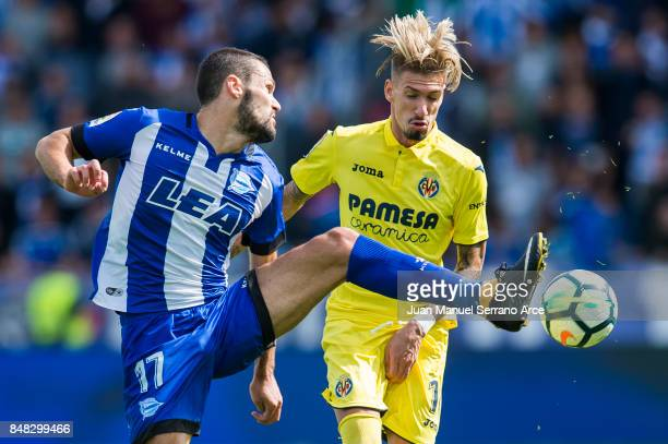 Samuel Castillejo of Villarreal CF duels for the ball with Alfonso Pedraza of Deportivo Alaves during the La Liga match between Deportivo Alaves and...