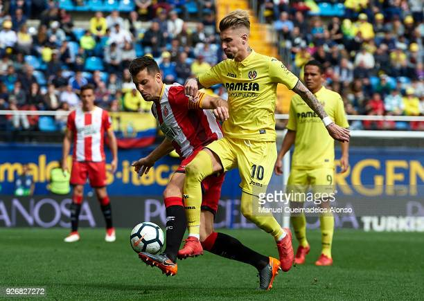 Samuel Castillejo of Villarreal competes for the ball with Alex Granell of Girona during the La Liga match between Villarreal and Girona at Estadio...