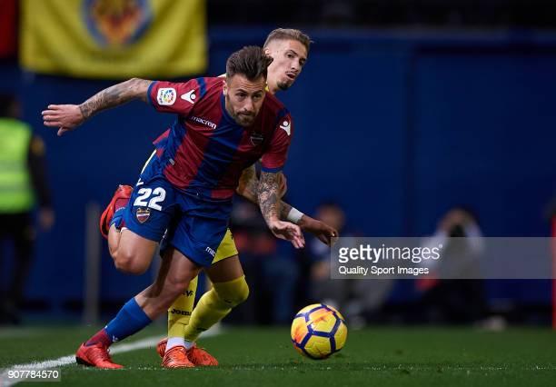 Samuel Castillejo of Villarreal competes for the ball with Antonio Luna of Levante during the La Liga match between Villarreal and Levante at Estadio...