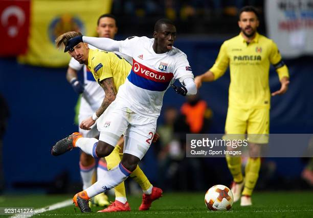 Samuel Castillejo of Villarreal competes for the ball with Ferland Mendy of Olympique Lyon during UEFA Europa League Round of 32 match between...