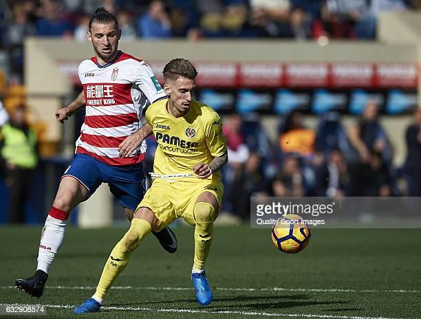 Samuel Castillejo of Villarreal competes for the ball with Gaston Silva of Granada during the La Liga match between Villarreal CF and Granada CF at...