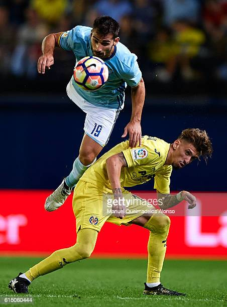 Samuel Castillejo of Villarreal competes for the ball with Jonathan Castro of Celta de Vigo during the La Liga match between Villarreal CF and Celta...