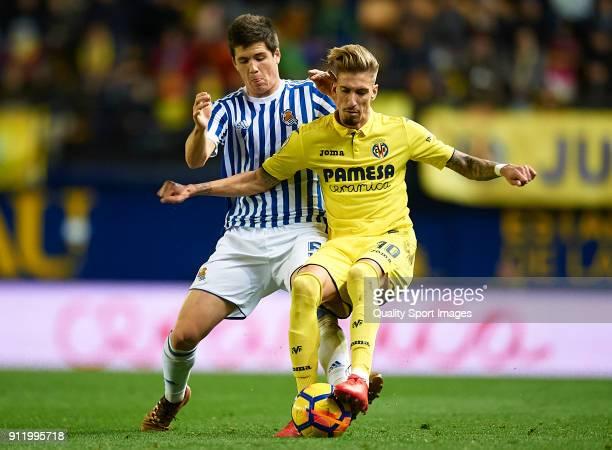 Samuel Castillejo of Villarreal competes for the ball with Zubeldia of Real Sociedad during the La Liga match between Villarreal and Real Sociedad at...