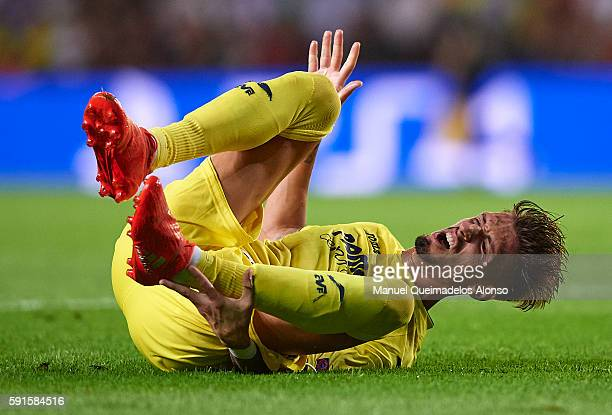 Samuel Castillejo of Villarreal lies injured on the pitch during the UEFA Champions League playoff first leg match between Villarreal CF and AS...