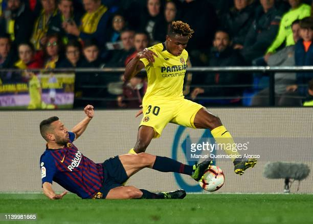 Samuel Chimerenka Chukweze of Villarreal competes for the ball with Jordi Alba of Barcelona during the La Liga match between Villarreal CF and FC...