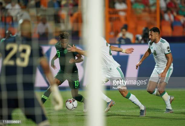 Samuel Chimerenka Chukwueze of Nigeria dribbling past Amir Selmane Rami Bensebaini of Algeria during the 2019 African Cup of Nations match between...