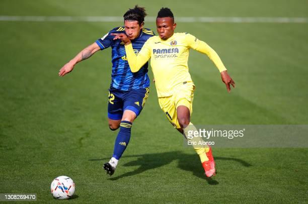Samuel Chukwueze of Villarreal CF looks to break past Alfonso Espino of Cadiz CF during the La Liga Santander match between Villarreal CF and Cadiz...
