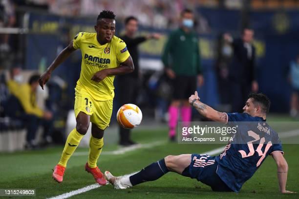 Samuel Chukwueze of Villarreal is challenged by GranitXhaka of Arsenal during the UEFA Europa League Semi-final First Leg match between Villareal CF...