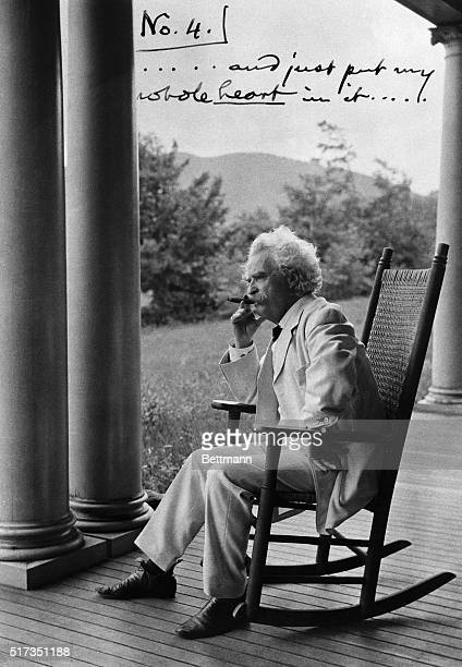 Samuel Clemens sits in a rocker on the front porch of his family's home in New Hampshire enjoying a cigar The annotated photograph was one in a...