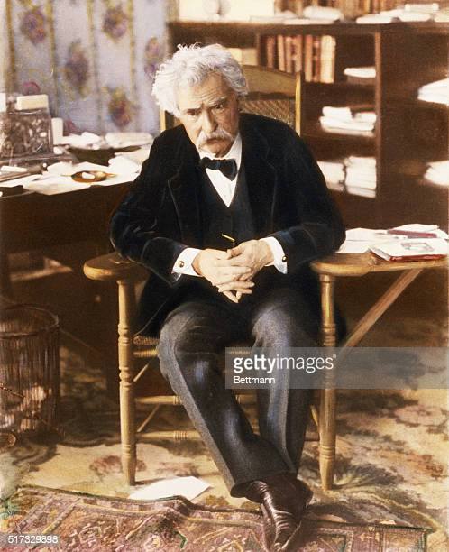 Samuel Clemens sits in his writing chair and appears to be concentrating intently 1903