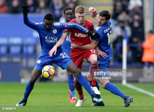 Samuel Clucas of Swansea City challenges for the ball with Wilfred Ndidi of Leicester City and Aleksander Dragovic of Leicester City during the...