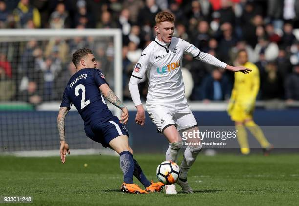 Samuel Clucas of Swansea City is challenged by Kieran Trippier of Tottenham Hotspur during The Emirates FA Cup Quarter Final match between Swansea...