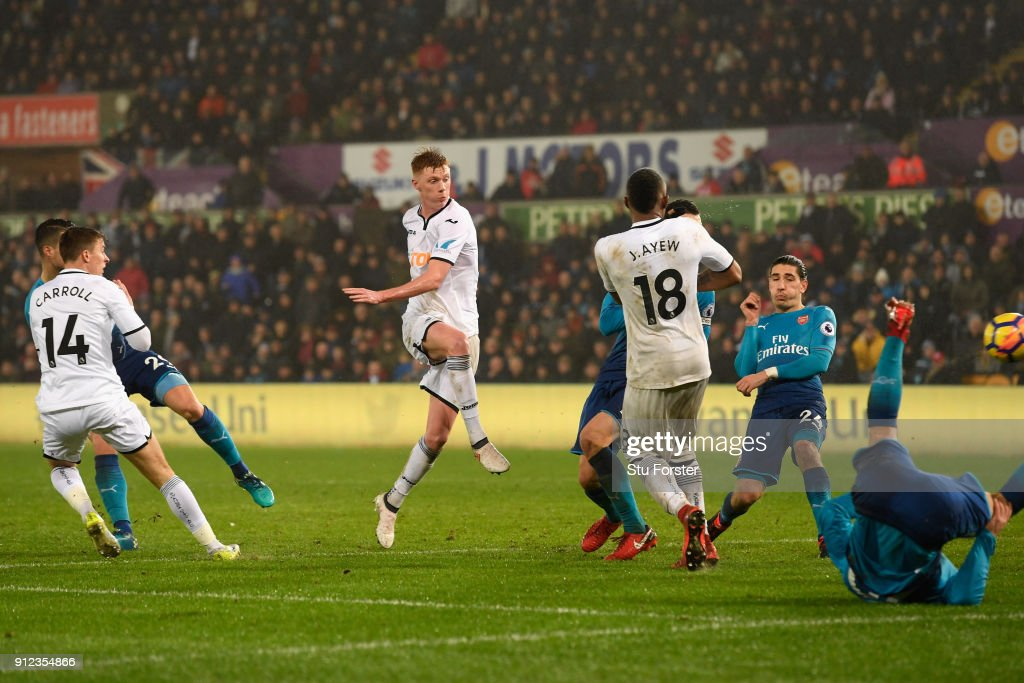 Samuel Clucas of Swansea City scores his sides third goal during the Premier League match between Swansea City and Arsenal at Liberty Stadium on January 30, 2018 in Swansea, Wales.