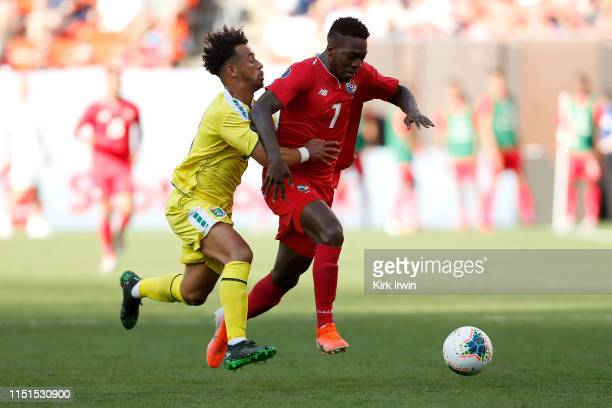 Samuel Cox of Guyana and Jose Rodriquez of Panama battle for control of the ball during the second half of the CONCACAF Gold Cup Group D match at...