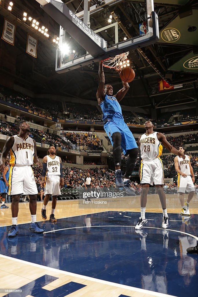 Samuel Dalembert #1 of the Dallas Mavericks dunks against the Indiana Pacers at Bankers Life Fieldhouse on October 16, 2013 in Indianapolis, Indiana.